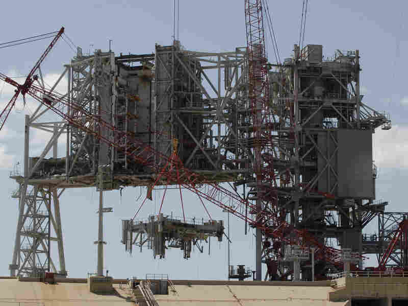 Cranes deconstruct a large section of the structure used to launch the space shuttles at launchpad 39B at Kennedy Space Center on April 6.