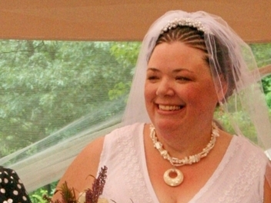 Lisa Lunt at her  wedding reception shortly after she got married in Massachusetts in 2008.   She and her wife have since split up, but are unable to divorce as their  home state of Rhode  Island doesn't recognize their marriage.