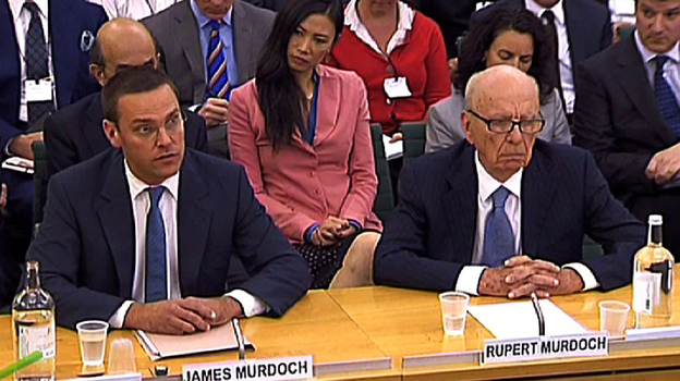 Rupert Murdoch and his son James during their testimony today in London. (AFP/Getty Images)