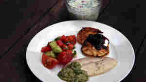 Traditional Soviet summer fare: a bowl of Okroshka (Cold Kefir Soup), Syrniki (Curd-Cheese Pancakes) with berries and sour cream, Grilled Trout with Tarragon and Cilantro Walnut Sauce, and Azerbaijan Salad.
