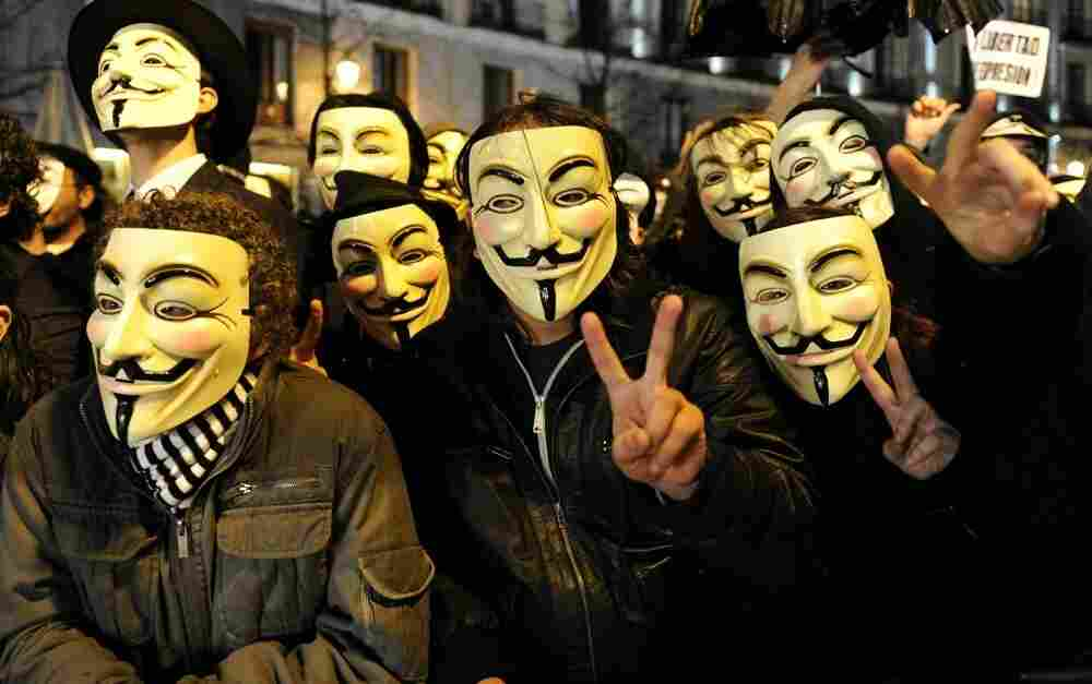 Members of the group Anonymous protest during Spain's film Goya Awards ceremony at Teatro Real in Madrid.