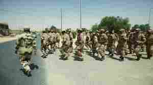 Specially selected rebel fighters march through the streets of Zintan, Libya. These rebels will be trained in urban combat in anticipation of an expected move toward Tripoli.