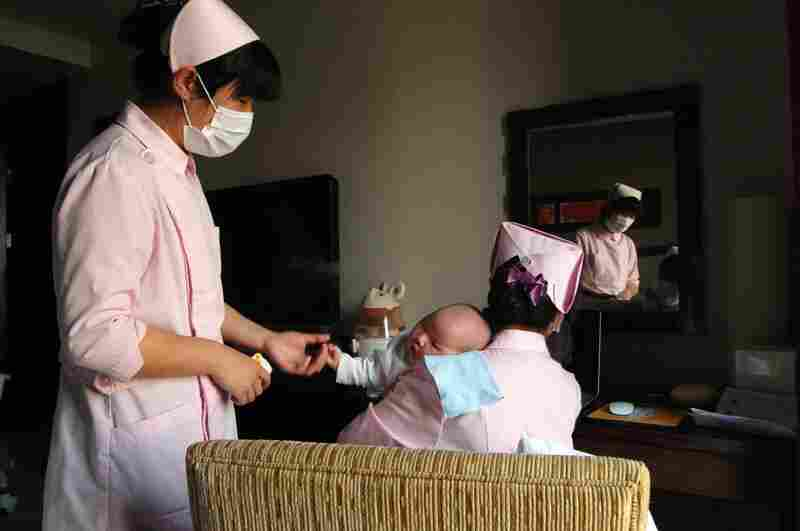 """Sitting the month"" is traditionally about letting the mothers recover from childbirth and restoring balance to their bodies through a special diet. At this luxury center, nurses take over when the babies fuss."