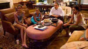 U.S. President Barack Obama, First Lady Michelle Obama, and their daughters Sasha and Malia watch the Women's World Cup while dining in the White House July 17, 2011 in Washington, DC.