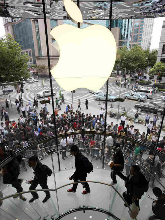 Customers line up at an Apple store for the launch of the iPhone 4 in Shanghai in 2010. Lines for everything from luxury handbags to social service programs can go on for days — literally. One entrepreneur in Shanghai will wait in line for you, for around $3 an hour.