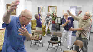 Volunteer John Kelley (left) leads an exercise class at a senior center in Oklahoma on Monday. Centers such as these offer seniors a cool place to go during heat waves.