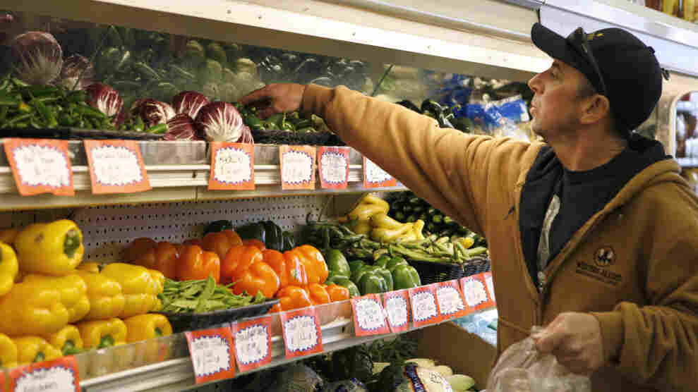 Kevin Gomes shops for produce at Pacifica Farmers Market in Pacifica, Calif., in March.