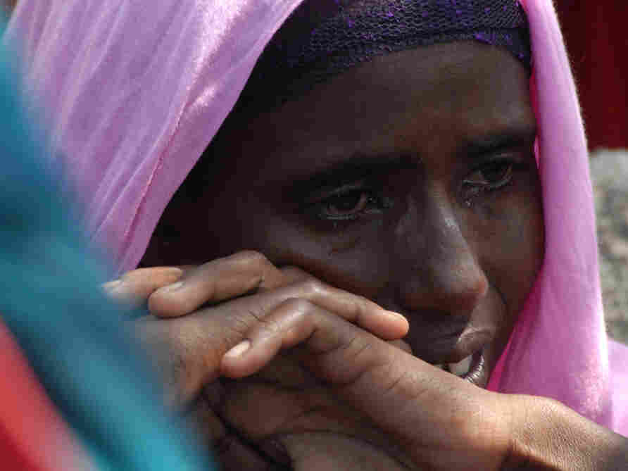 Monday (July 18, 2011): At a refugee camp near Mogadishu, a Somali woman cries after the death of one of her children.