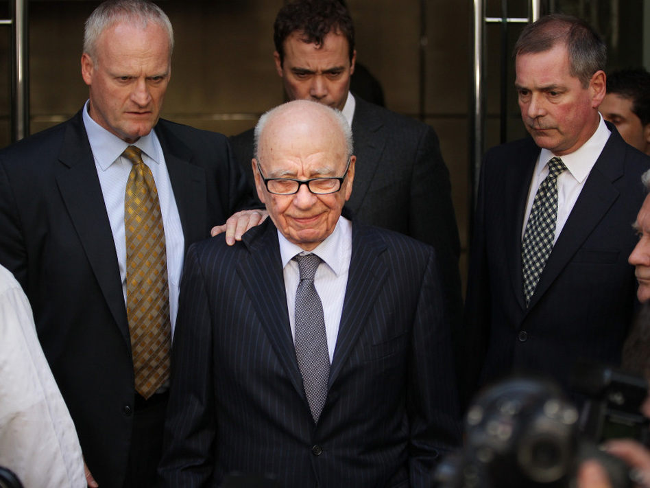 "News Corp. Chairman Rupert Murdoch, at center on July 15, after News International chief executive Rebekah Brooks announced her resignation. Speaking before British lawmakers yesterday, Murdoch said ""This is the most humble day of my life."""