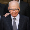 """News Corp. Chairman Rupert Murdoch, at center on July 15, after News International chief executive Rebekah Brooks announced her resignation. Speaking before British lawmakers yesterday, Murdoch said """"This is the most humble day of my life."""""""