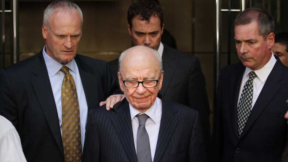 "News Corp. Chairman Rupert Murdoch, at center on July 15, after News International chief executive Rebekah Brooks announced her resignation. Speaking before British lawmakers yesterday, Murdoch said ""This is the most humble day of my life."" (Getty Images)"
