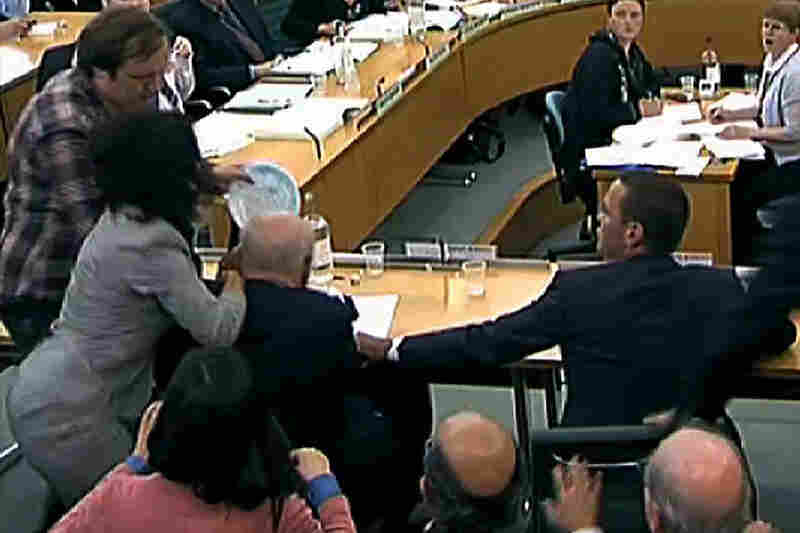 Protester Jonathan May-Bowles (top left) hit News Corp. Chief Rupert Murdoch in the face with what British media reported to be a plate of shaving cream as Murdoch and son James presented evidence to a parliamentary committee investigating the News of the World phone-hacking scandal in London. While this incident caused a stir in Parliament, Murdoch is now part of a long history of  pies...