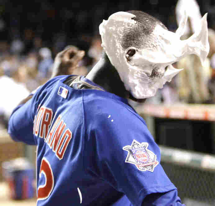 A shaving cream pie in the face is a regular occurrence in Major League Baseball when a player gets the winning hit. Alfonso Soriano of the Chicago Cubs gets it from Ryan Theriot after hitting a grand slam that gave the Cubs a 5-1 win against the Houston Astros in 2009, at Wrigley Field in Chicago.