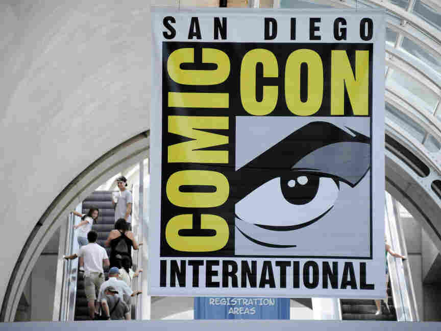 Fans arrive during Preview Night at the Comic-Con 2011 convention Wednesday, July 20, 2011 in San Diego.