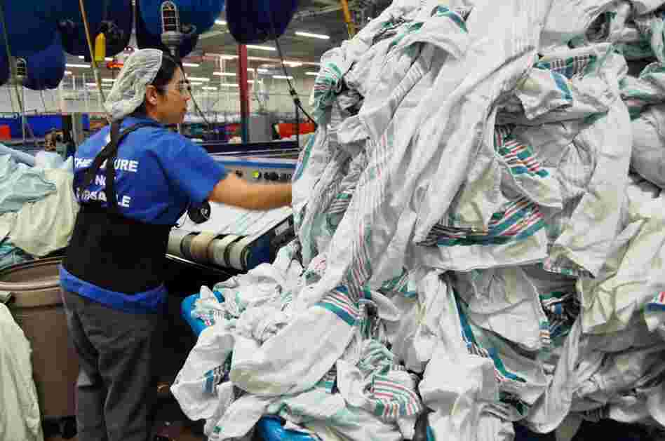 Maria Murillo processes clean baby blankets at Healthcare Laundry Systems in Wheeling, Ill. Last year, the laundry purchased 180,000 blankets to supply to hospitals around Chicago. Each blanket lasts approximately 15 washes before it's thrown out or lost.