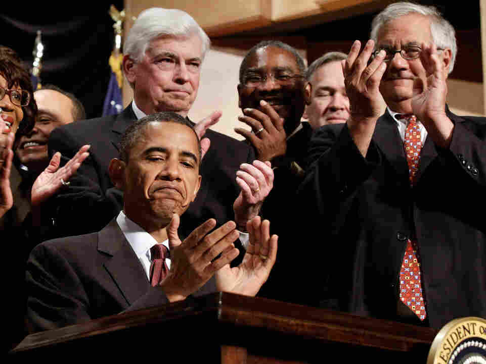 President Obama (with Dodd and Frank) after the bill into law.