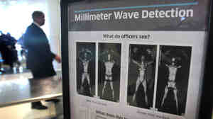 A sign at Chicago's Midway Airport informs travelers about the millimeter wave scanners used