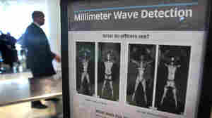 A sign at Chicago's Midway Airport informs travelers about the millimeter wave scanners used to screen passengers.