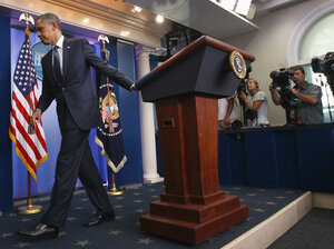 President Obama walks away from the Brady Press Briefing Room earlier this week, after a brief statement on ongoing debt ceiling negotiations with congressional leaders.