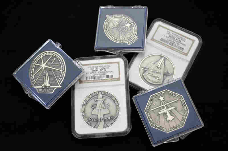 Only astronauts could purchase these medallions (which collectors refer to by the name of the company that minted them). Minted in low number in both gold and silver, some flew aboard the missions they commemorate.  Pictured clockwise from top: Robbins medals for missions STS-116, STS-1, STS-121, STS-95 and STS-115.