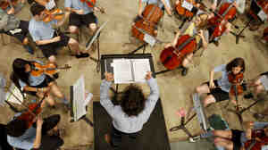 Cellist Sara Page (center, right) rehearses with the World Youth Symphony Orchestra at Interlochen Arts Camp. Page is among the campers who made an exceptional effort to raise funds to attend the camp this year.