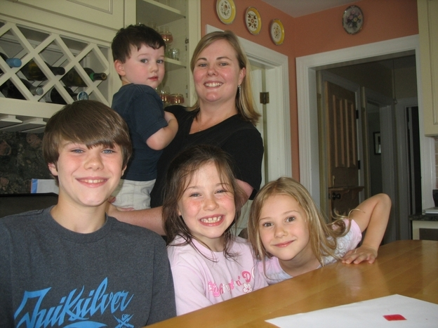 Sarah Bullard with her four children, Liam, Fay, Olivia and Joshua. They bought a house in Bristol, R.I., but then Bullard's husband got orders to work at the Pentagon. So now they live apart.