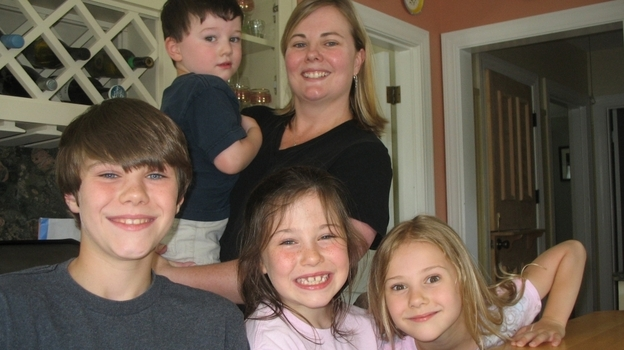 Sarah Bullard with her four children, Liam, Fay, Olivia and Joshua. They bought a house in Bristol, R.I., but then Bullard's husband got orders to work at the Pentagon. So now they live apart. (WRNI)
