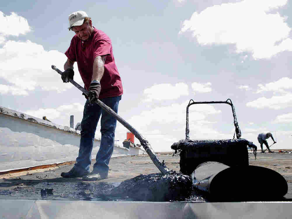 Harold Ferslew, owner of Capitol Roofing Company, spreads 550 degree hot tar on a roof on July 20, 2011 in Oklahoma City, Oklahoma. In our second hour, meteorologists talk about the severe heat wave affecting much of the U.S.