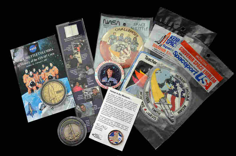Memorabilia related to the two space shuttle tragedies: Challenger's STS-51L mission in 1986 and Columbia's STS-107 mission in 2003. Many people saved items from these flights to have a tangible memory of the fallen astronauts and the lost orbiters.