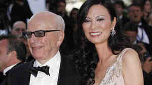 Media magnate Rupert Murdoch, left, and his wife Wendi Deng Murdoch arrive for the screening of The Tree of Life at the 64th international film festival, in Cannes, southern France on May 16. Rupert Murdoch has come under fire recently as reports come to light that employees of some of his news organizations hacked into cell phones to get story leads.