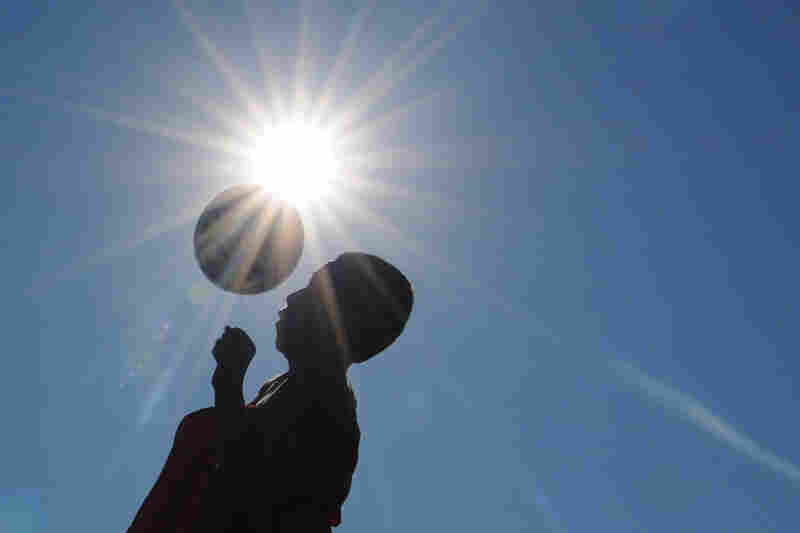 A member of the Salina South High School soccer team works out early Wednesday in Salina, Kan.