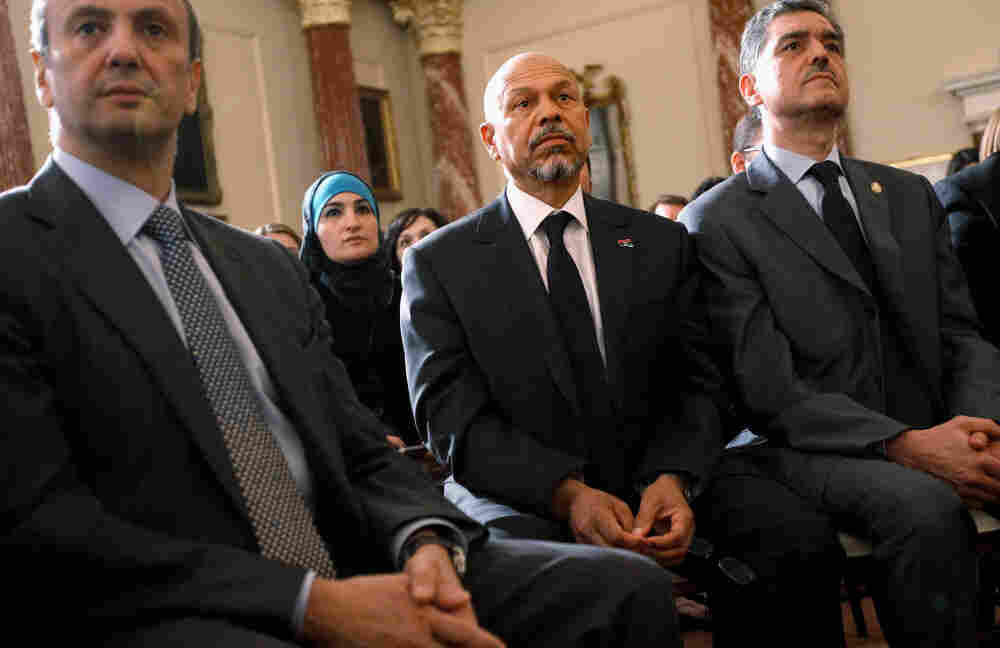 Ali Aujali (second from right) listens to President Obama speak at the State Department in May. Aujali was Moammar Gadhafi's ambassador to the U.S., but resigned after the Libyan uprising began. He now represents the rebels' Transitional National Council.
