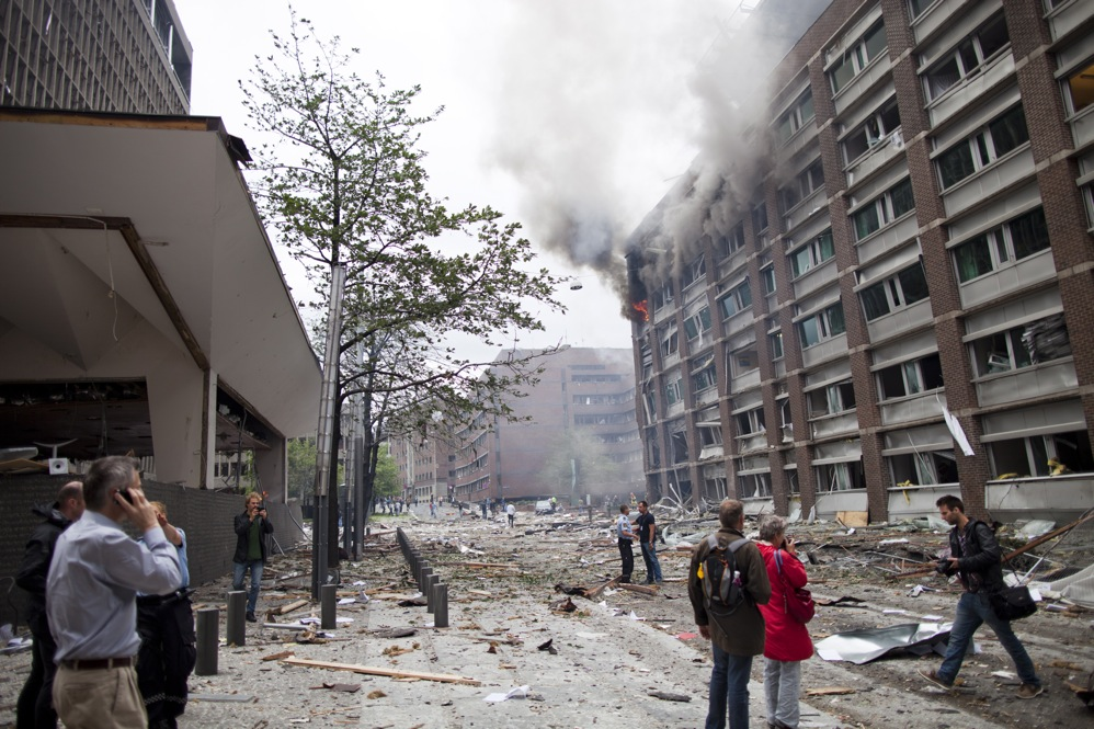Debris covers the street outside buildings in the center of Oslo following Friday's explosion, which tore open several government buildings, including the prime minister's office.