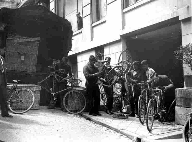 Cyclists in the 1930 race fix their bicycles during a rest day in Belfort. That year the Tour organizer, Henri Desgrange, ordered all cyclists to be formed into regional teams rather than manufacturers' teams. The participants all had to ride plain yellow bikes for the first time.
