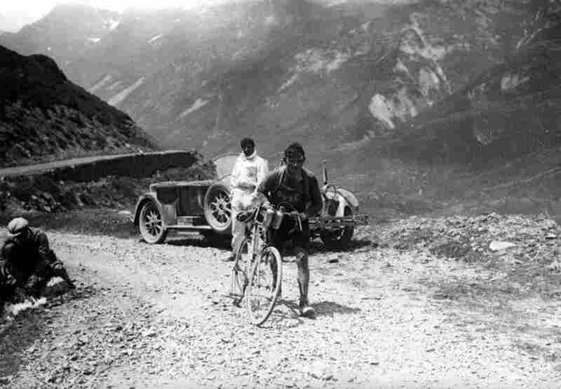 Belgian cyclist Maurice Geldhof climbs part of Col d'Aubisque — a mountain pass in the Pyrenees — on foot during the 1928 race. Nicholas Frantz of Luxembourg would win the race that year, finishing the last stage on a woman's bike after damaging his own riding over a railroad track.
