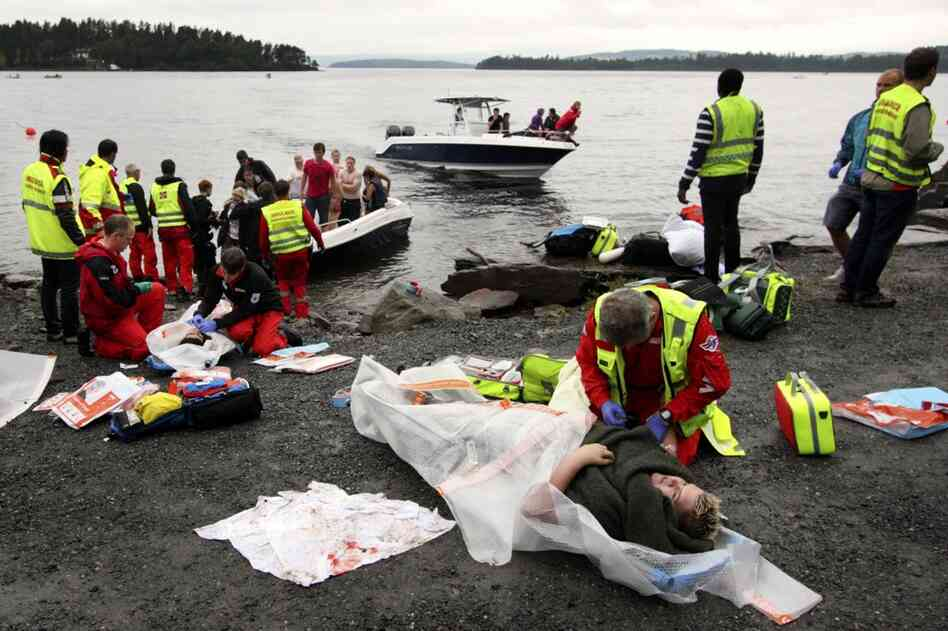 Emergency personnel check on victims who were rescued from the water.