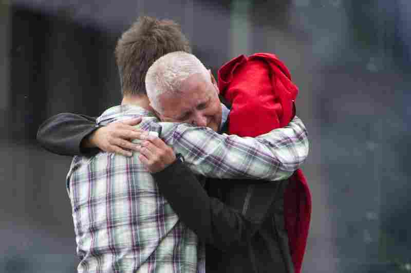 A survivor of the camp shooting embraces his father in Sundvolden, about 25 miles outside Oslo.