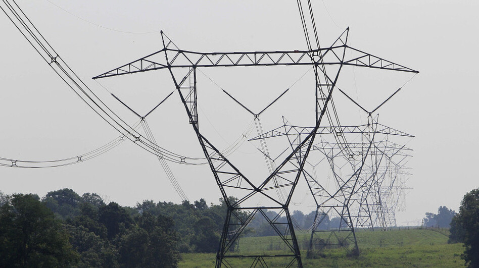 Electric lines extend over the hills of Owen County near Owenton, Ky. A lengthy, blistering heat wave that is blanketing the eastern United States is putting significant stress on the nation's power grid as homeowners and businesses crank up their air conditioners.