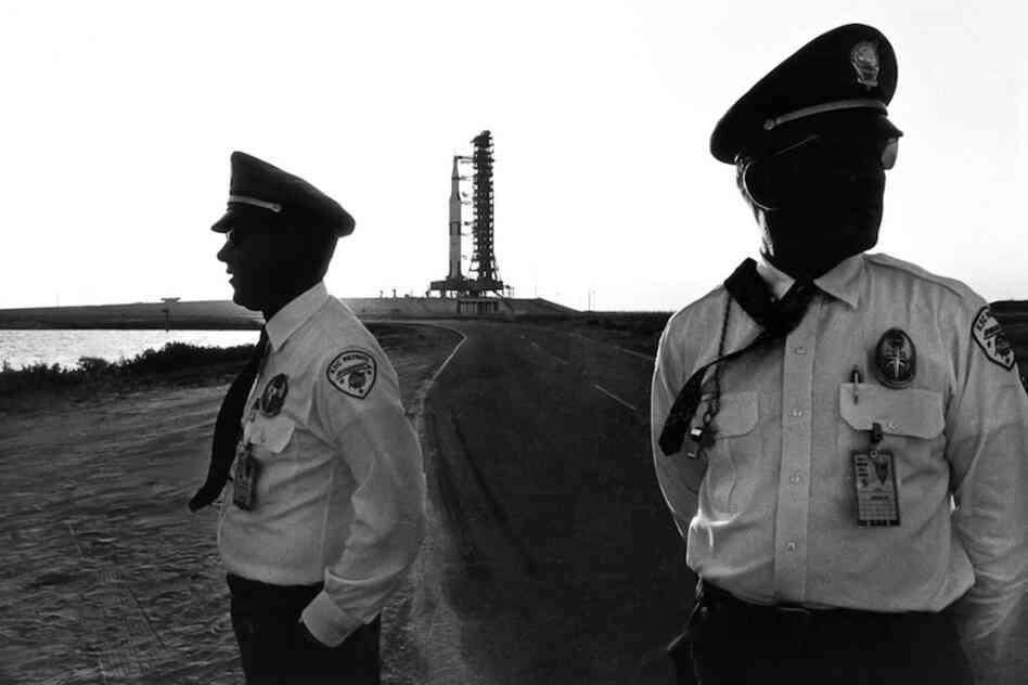 Security guards at the perimeter of launchpad 39A and the Saturn Apollo 16 moon rocket on the eve of its launch in April 1972. John Young, the commander of Apollo 16, would — nine years later to the month — be the first commander on the maiden launch of the space shuttle program in April 1981.