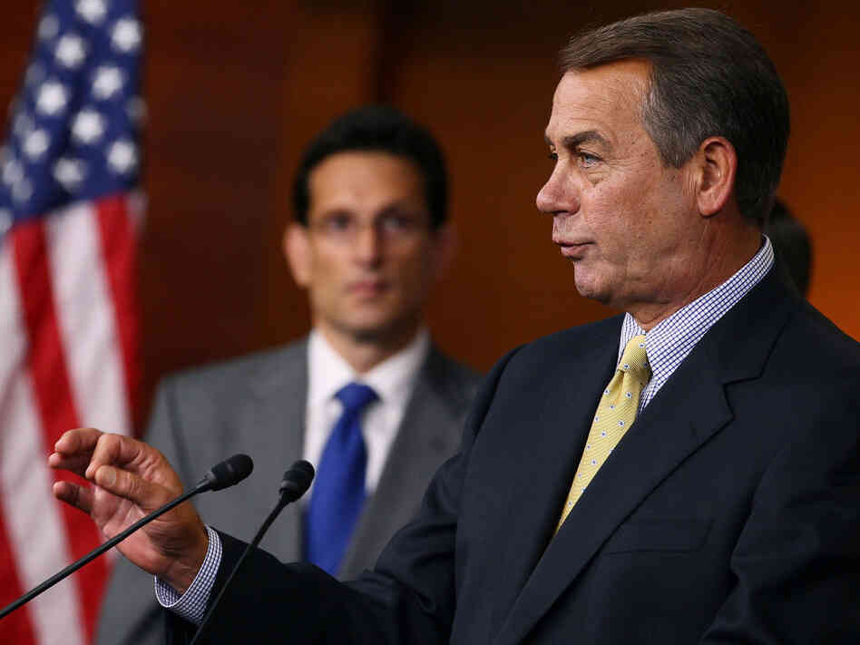 House Speaker John Boehner makes a point at a news conference as Majority Leader Eric Cantor listens, July 22, 2011.