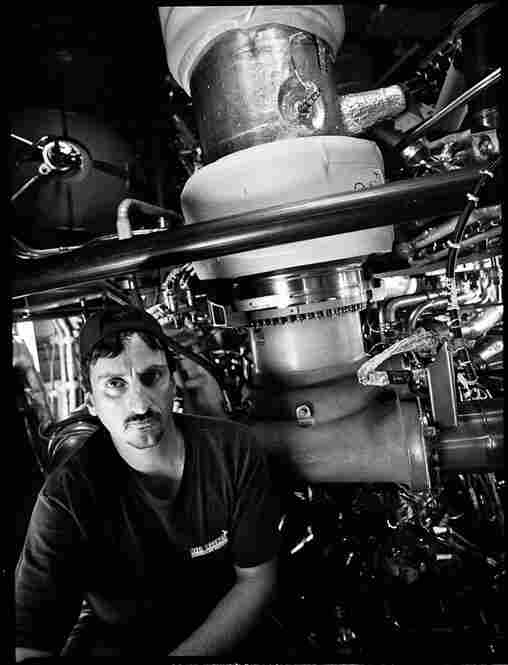 United Space Alliance technician Jim Deleie in the shuttle Atlantis' rocket engine compartment in April 2009.  Now that the last shuttle has flown, Deleie will most likely return to Orlando International Airport to his former position as an aircraft jet engine mechanic.