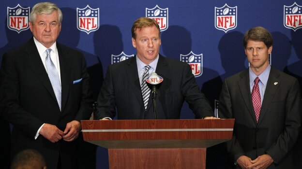 NFL Commissioner  Roger Goodell, center, announces NFL  owners have agreed to a tentative agreement that would end the lockout  pending player approval. Carolina Panthers owner Jerry Richardson, left, and Kansas City  Chiefs owner Clark Hunt look on.