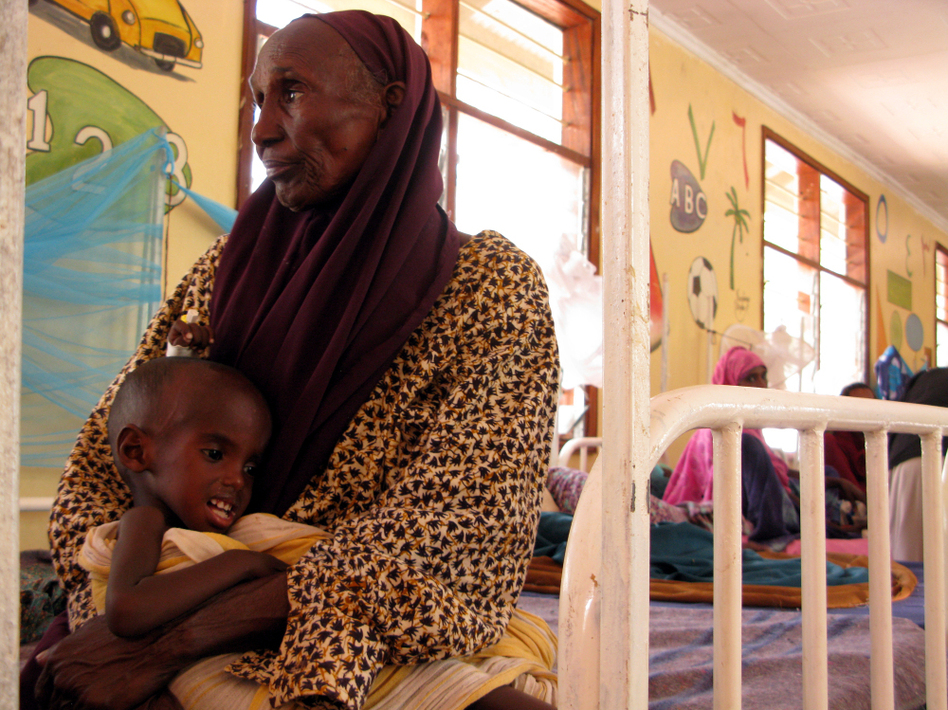 Hawa Hassan cradles her grandson, Adan Abdon, 3, who is suffering from malnutrition. Adan's mother died during the 30-day walk from southern Somalia to Kenya.