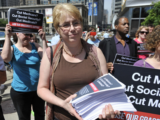 Jan Bees, a member of the Progressive Change Campaign Committee, opposes potential cuts to Medicare, Medicaid and Social Security. She and others walked to  President Obama's campaign headquarters in Chicago last week to deliver 200,000 signatures from people who would refuse to donate or volunteer for his re-election campaign if Obama cuts entitlement programs. (AP)