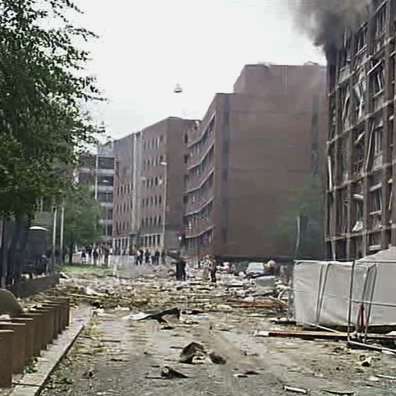 In this video image taken from television, smoke is seen billowing from a damaged building as debris is strewn across the street after an explosion in Oslo, Norway, today (July 22, 2011).