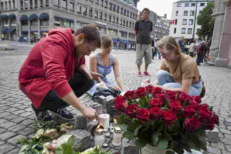 People light candles and lay flowers in central Oslo, Norway, on Saturday to pay tribute to the victims of twin attacks a day earlier. At least 91 people died in an explosion at government offices in the capital and a shooting at a youth camp on nearby Utoya island.