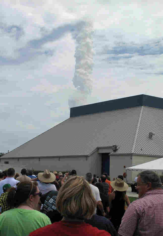 Atlantis quickly vanished into the clouds, leaving behind a massive column of thick smoke, and an audience in awe.