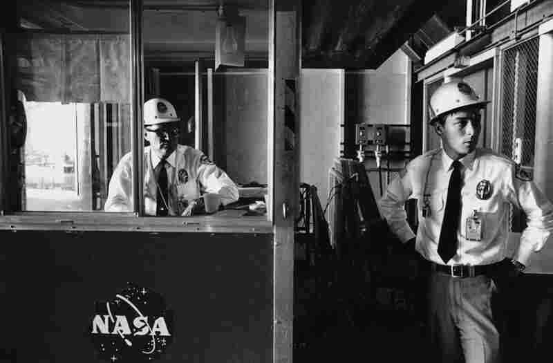 Security guards watch the entrance of the Vertical Assembly Building where the Saturn V rocket and Apollo module and lander are configured for launch in April 1972.