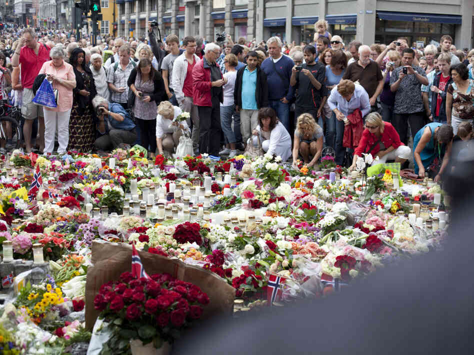Mourners gather outside the Domkirken Church in Oslo on Sunday, following a mass for victims of the July 22 government office bombing and shooting spree at a Labour Youth League camp. At least 93 were killed and nearly 100 were wounded in Friday's attacks.