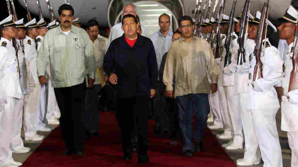 Venezuelan President Hugo Chavez (wearing red) arrives in Caracas from Cuba on July 23, 2011.